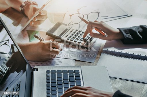 istock business teamwork with working new project. concept finance accounting in office 906822288