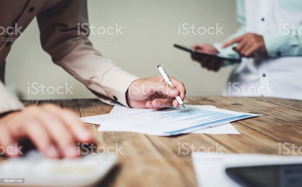 Business teamwork working on their jobs seriously. stock photo