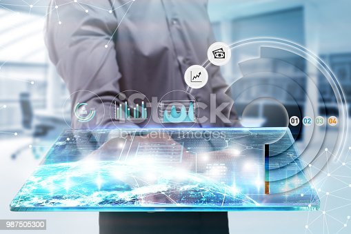 istock Business, Technology, Internet and network concept. Young businessman working on a tablet of the future, he sees the inscription 987505300