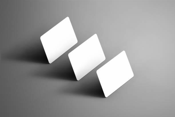 business-template von einem drei bank (geschenk) karten auf einem grauen hintergrund isoliert. - gutschein ausdrucken stock-fotos und bilder