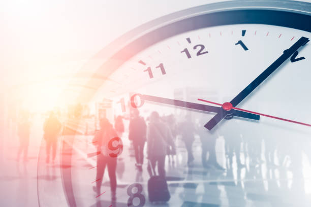 Business times concept people walking overlay with time clock Business times concept people walking overlay with time clock time zone stock pictures, royalty-free photos & images