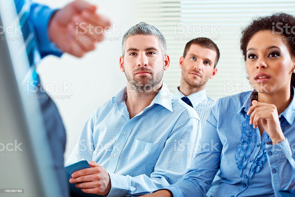 Business training Group of business people during business seminar, listening to presentation. 30-34 Years Stock Photo