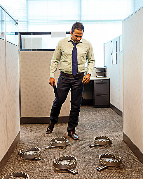 Business Trap A businessman comes across a spring trap in the hallway of their office. ambush stock pictures, royalty-free photos & images