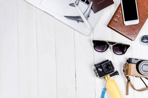 business travel blogger objects and equipment on white wooden copy space - phone, travelling, copy space imagens e fotografias de stock