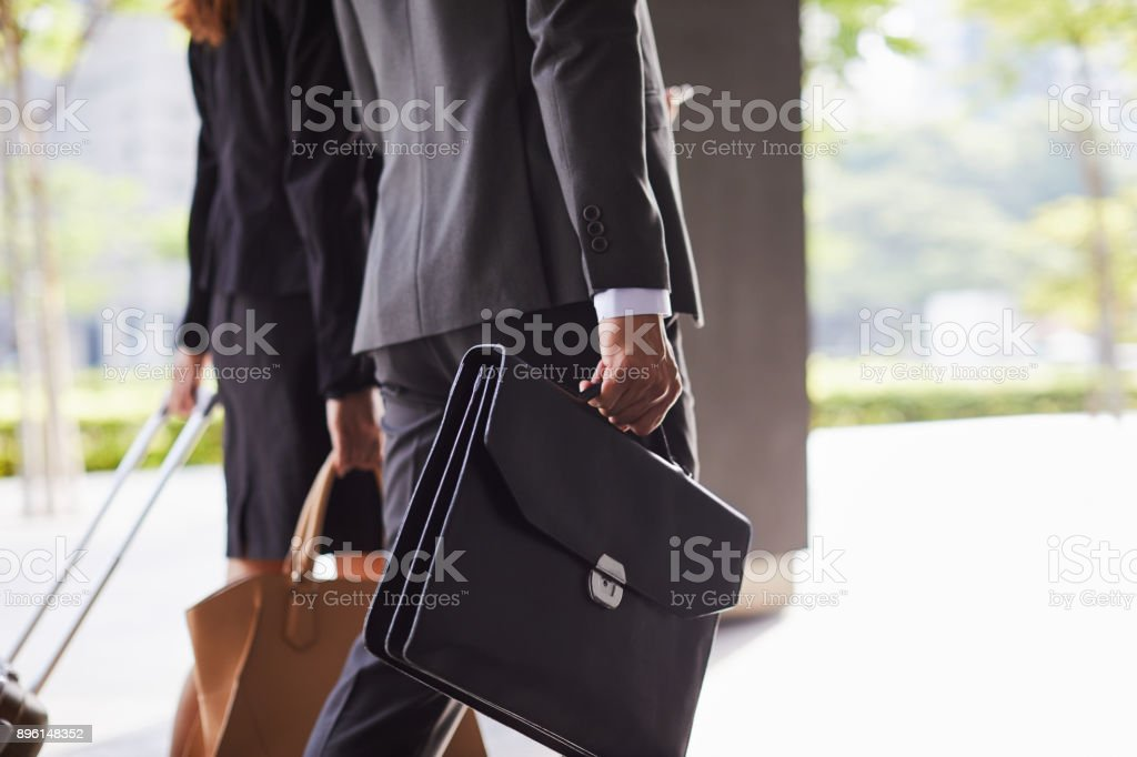 Business Travel detail of briefcase and suitcase. stock photo