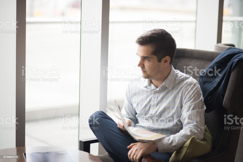 Business Travel in lobby of hotel with well dressed man stock photo