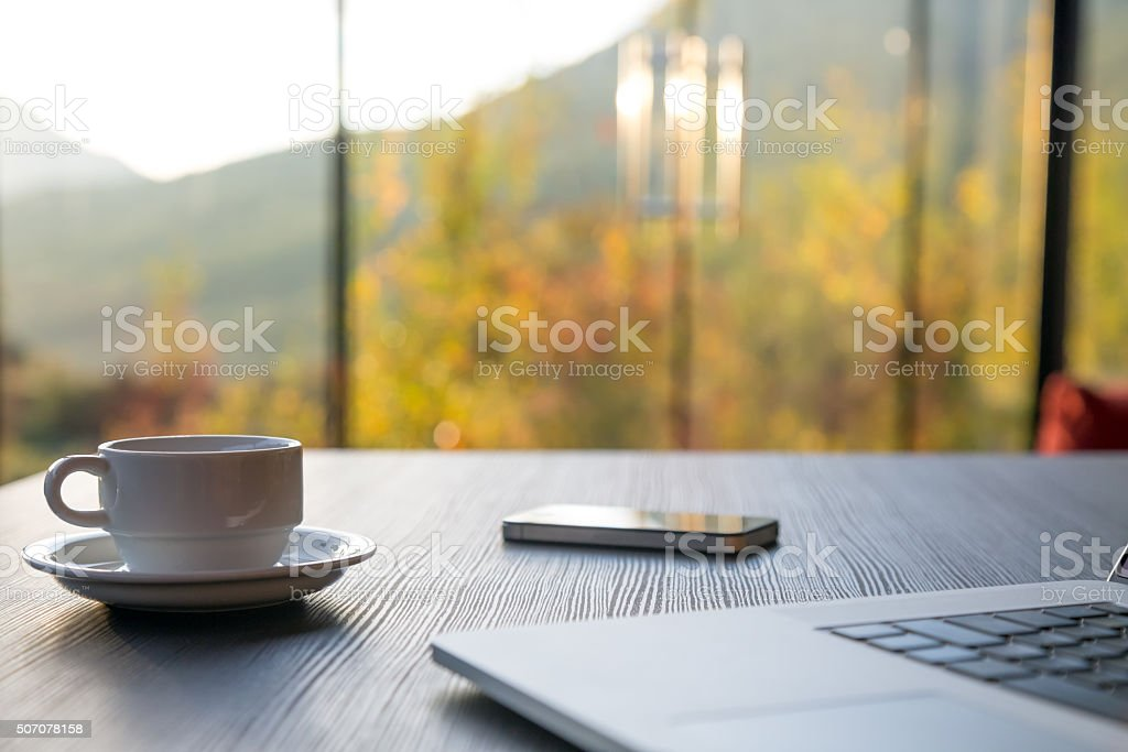 Business Travel Morning Composition with Computer Coffee and Telephone stock photo