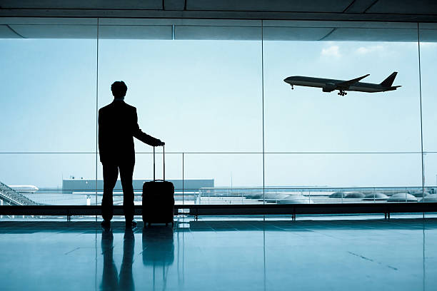 business travel - airport terminal stock photos and pictures