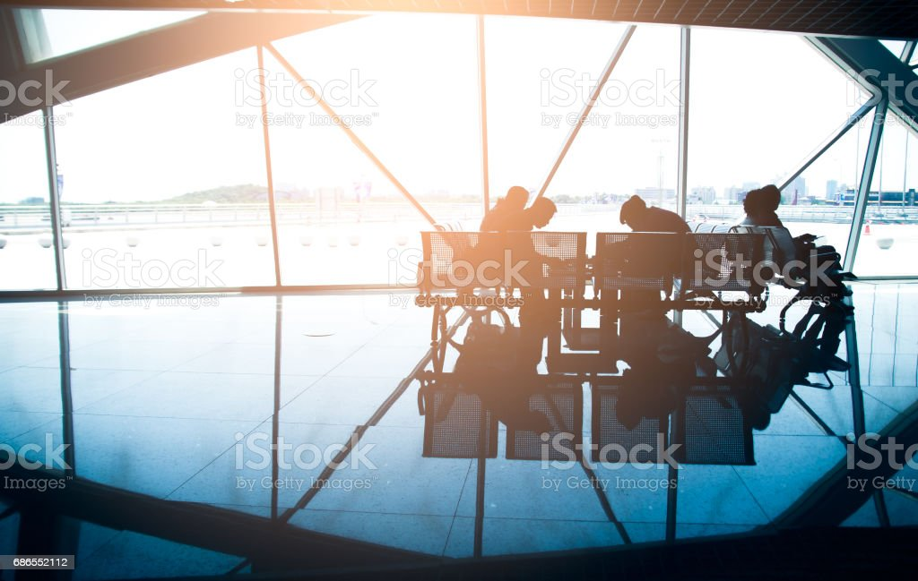 business travel, silhouettes at airport at Thailand royalty-free stock photo