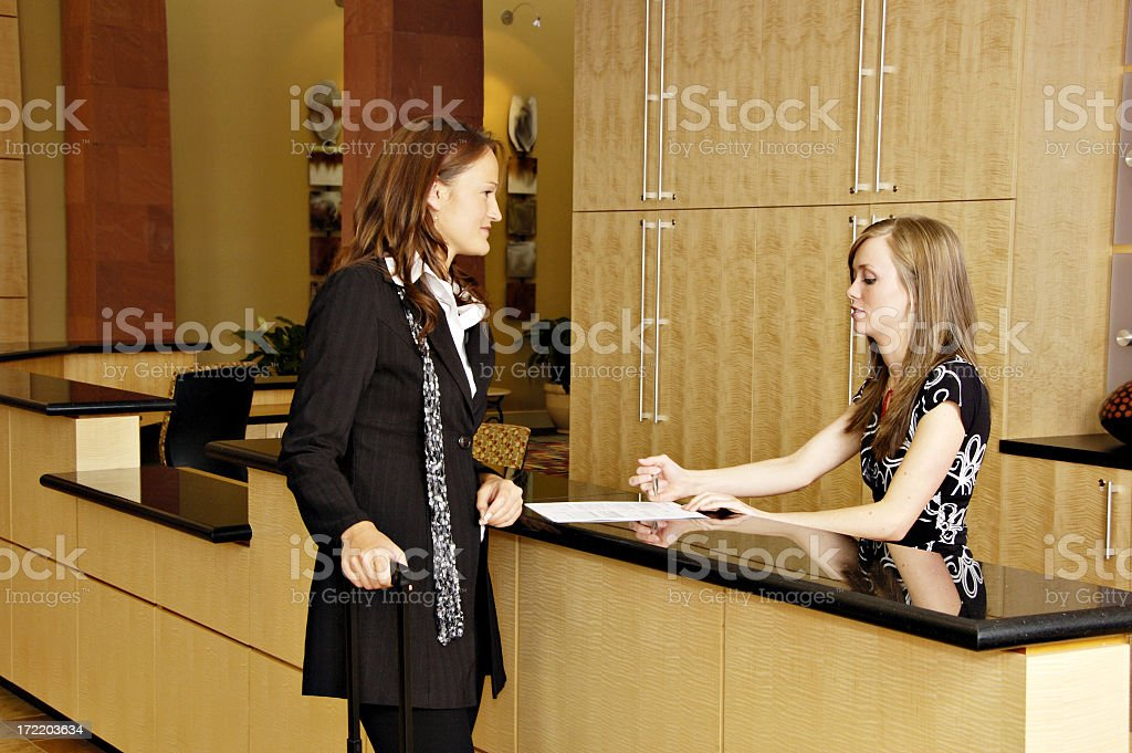 Business traveler about to sign papers stock photo
