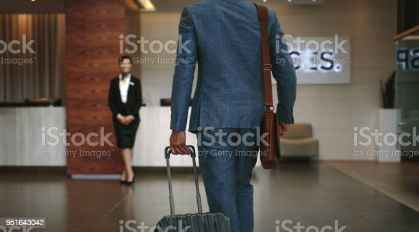 Business traveler arriving at hotel picture id951643042?b=1&k=6&m=951643042&s=612x612&h=p7tpz9b9j1toixbi4phc2hzqsdxyn9nrxo9vfpdvq0i=