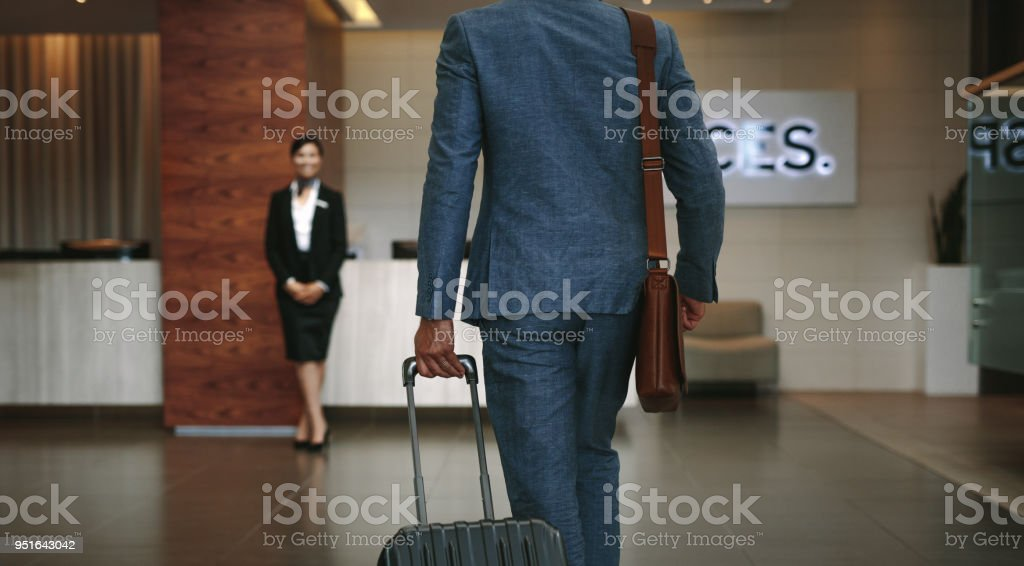 Business traveler arriving at hotel stock photo