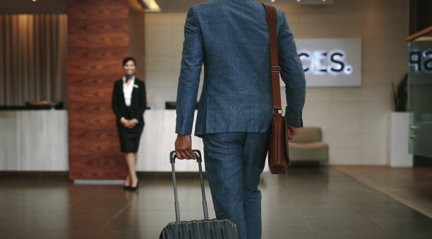 business traveler arriving at hotel - airport check in counter stock pictures, royalty-free photos & images