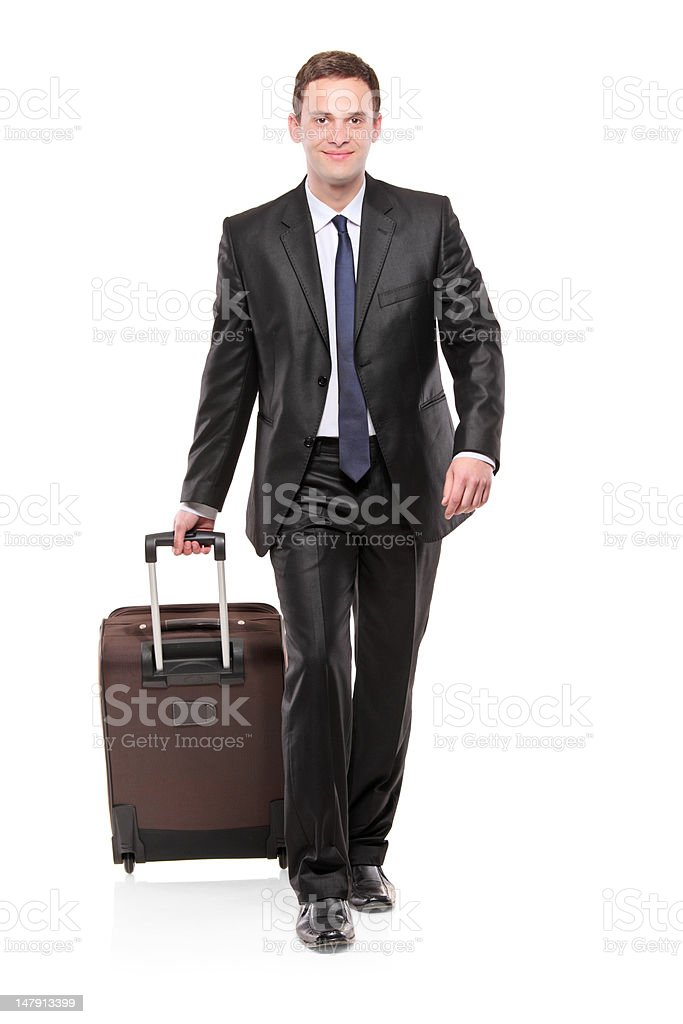 Business traveler carrying a suitcase royalty-free stock photo
