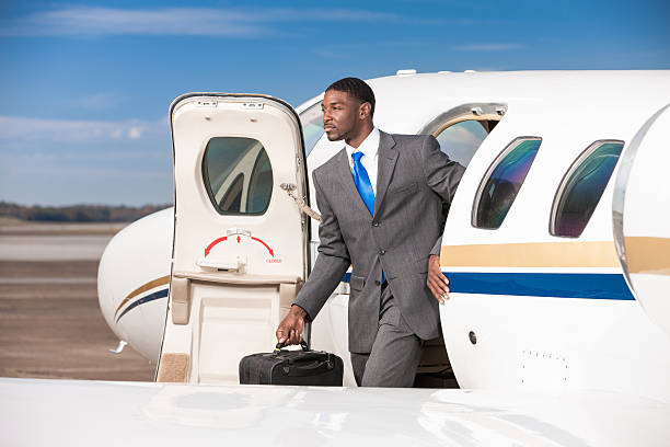 Business Traveler Exiting Private Corporate Jet stock photo