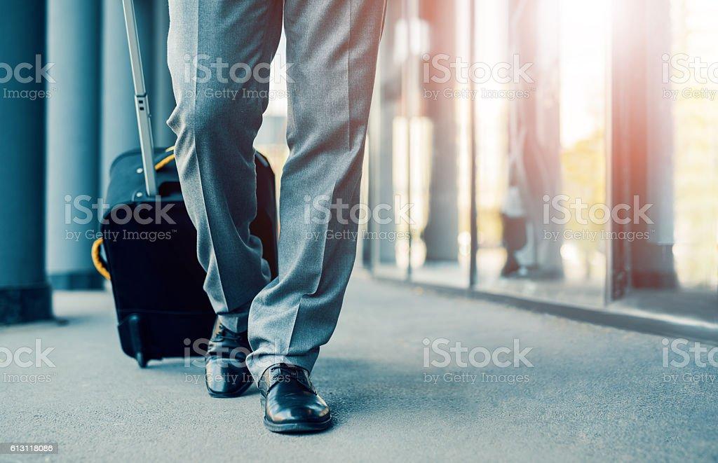 Business traveler pulling suitcase stock photo