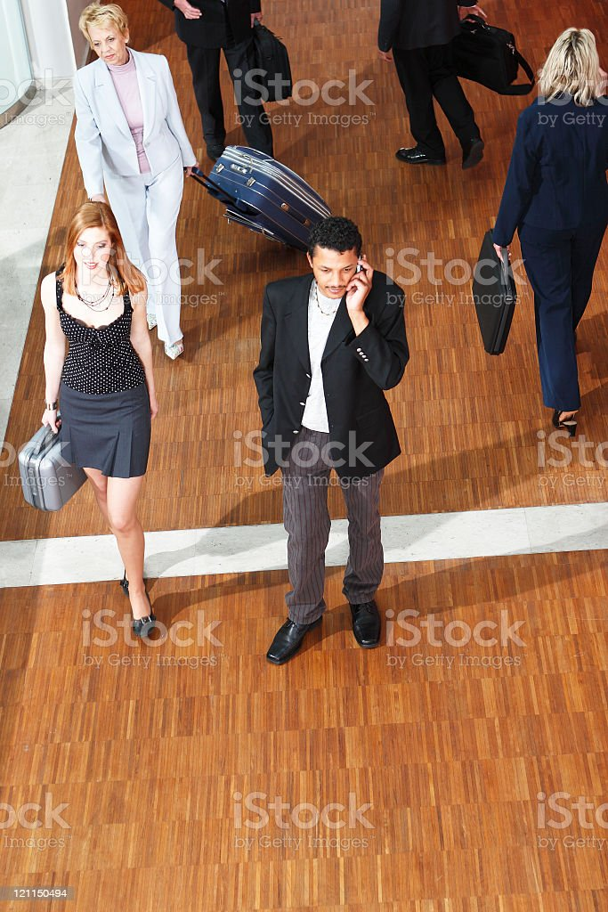 Business Traveler taking a phone call stock photo