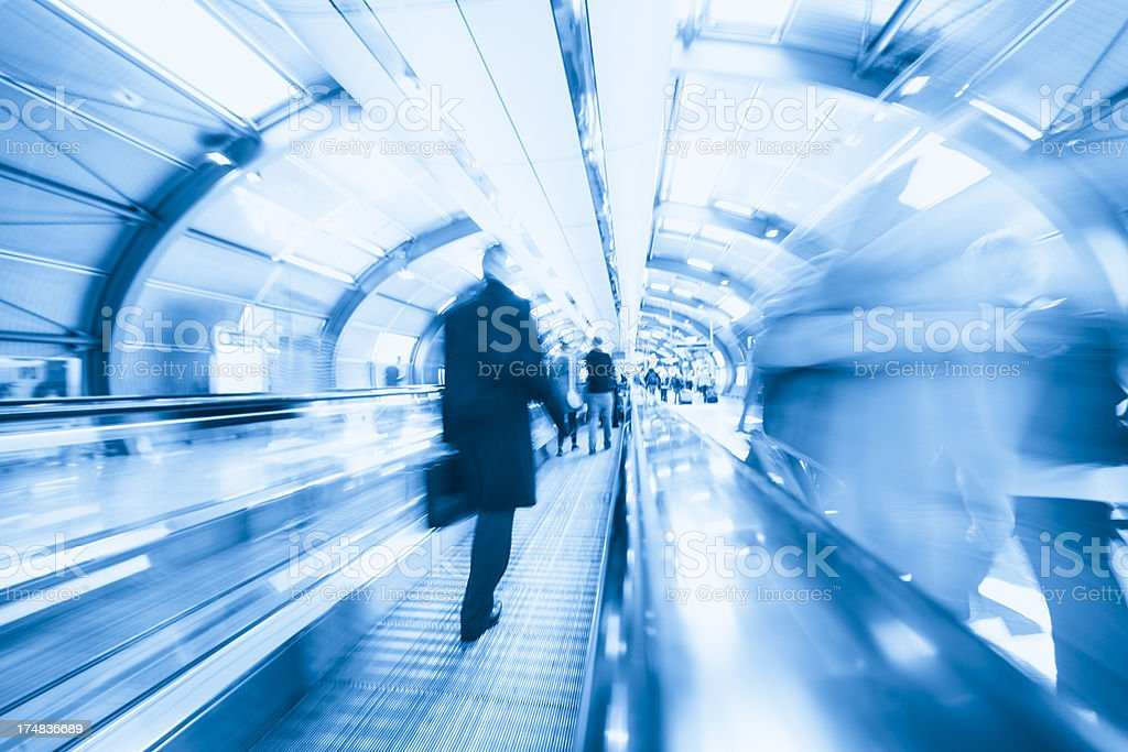 Business traveller on moving walkway at Frankfurt airport royalty-free stock photo