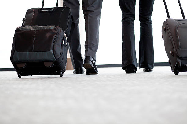 business travellers walking in airport stock photo