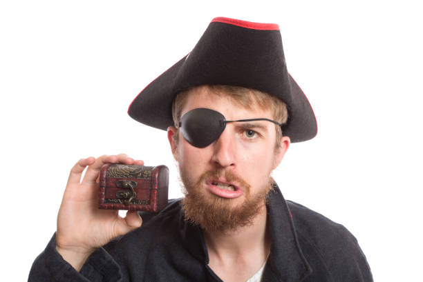 business treasure A pirate disappointed with the size of his treasure. Concepts. costume eye patch stock pictures, royalty-free photos & images