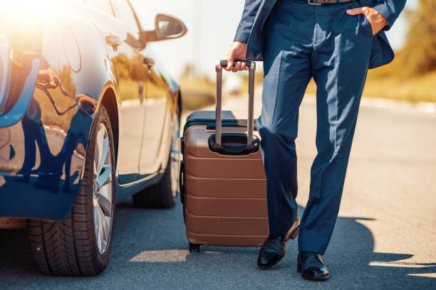 Business trip Traveling businessman with his luggage near car. luxury car stock pictures, royalty-free photos & images