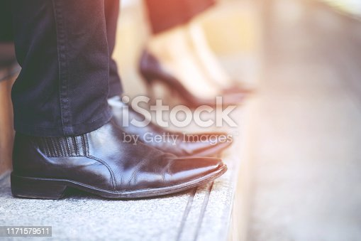684803840istockphoto Business two people walking upstairs ,Fighting against obstacles Climb up to Successful finish we will walk together concept 1171579511