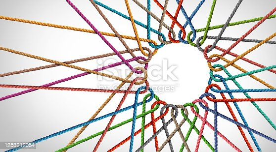 Business Unity and connection partnership as ropes shaped as a circle in a group of diverse strings connected together shaped as a support symbol expressing the feeling of teamwork and togetherness.