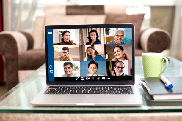 Business video call meeting on laptop at home stock photo