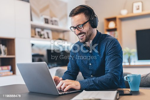 Handsome businessman having Video Conference at home