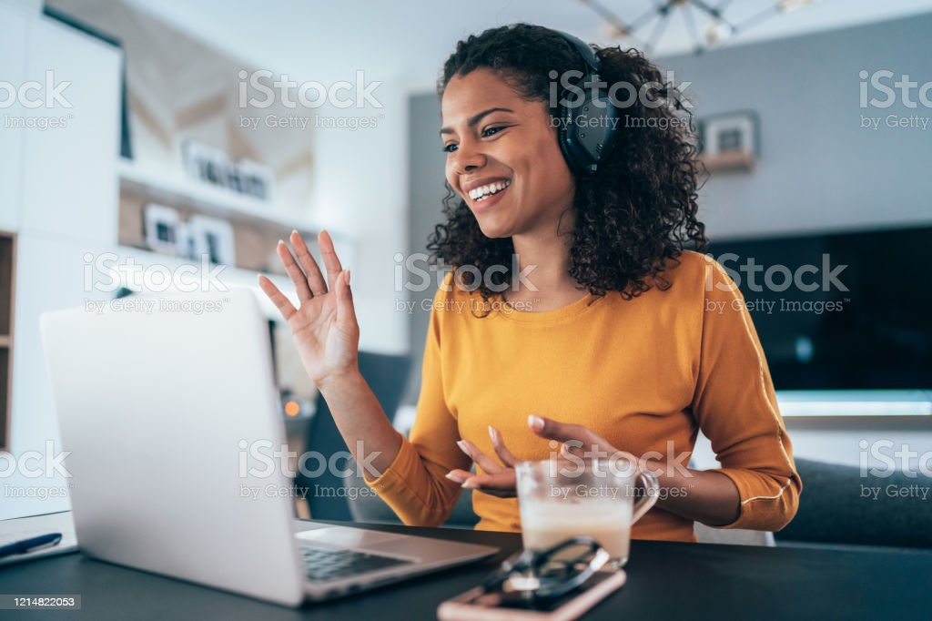 Business Video Conference Young modern woman having Video Conference at home 30-39 Years Stock Photo