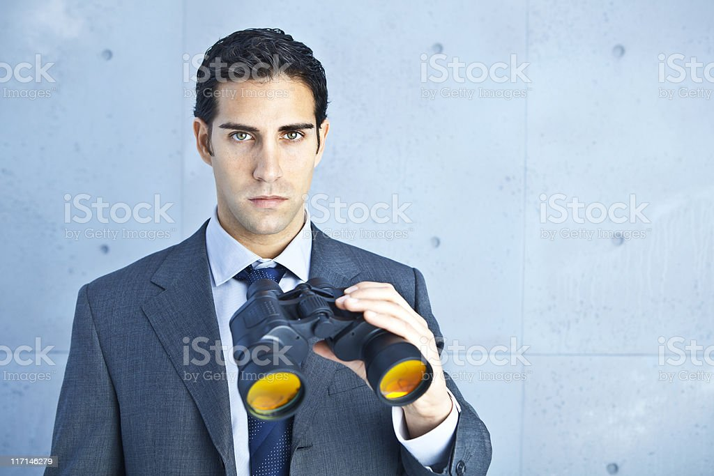Business vision: man holding binoculars royalty-free stock photo