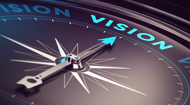 Business Vision Compass with needle pointing the word vision with blur effect plus blue and black tones. Conceptual image for immustration of company or business anticipation or strategy the way forward stock pictures, royalty-free photos & images
