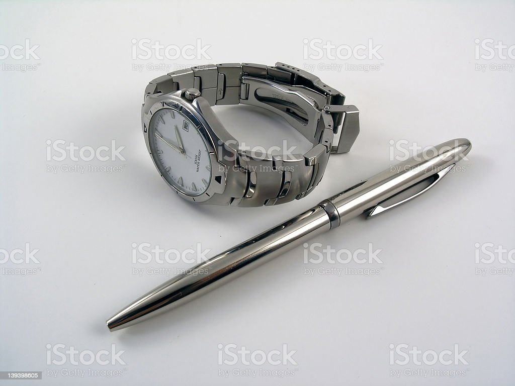 Business watch near a silver ball pen royalty-free stock photo
