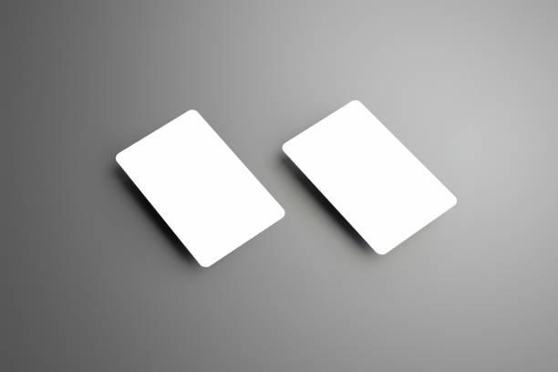 geschäftliche weißen mock-up von zwei bank geschenkkarten isoliert auf einem grauen hintergrund - gutschein ausdrucken stock-fotos und bilder