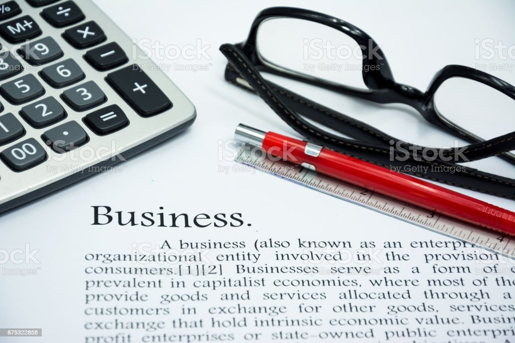 Business with pen on text focus word stock photo