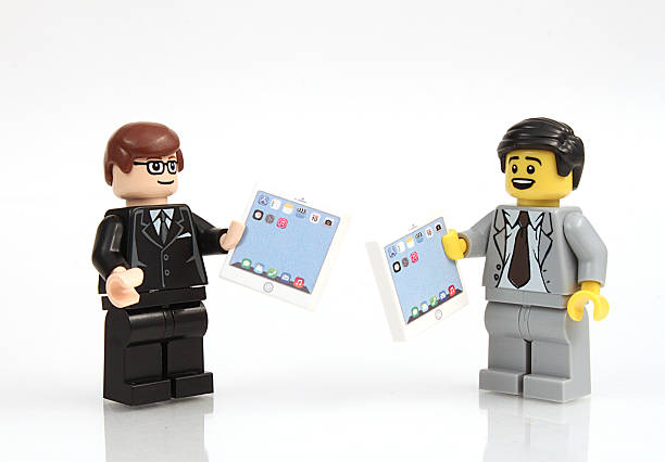 business with tablets - lego stockfoto's en -beelden