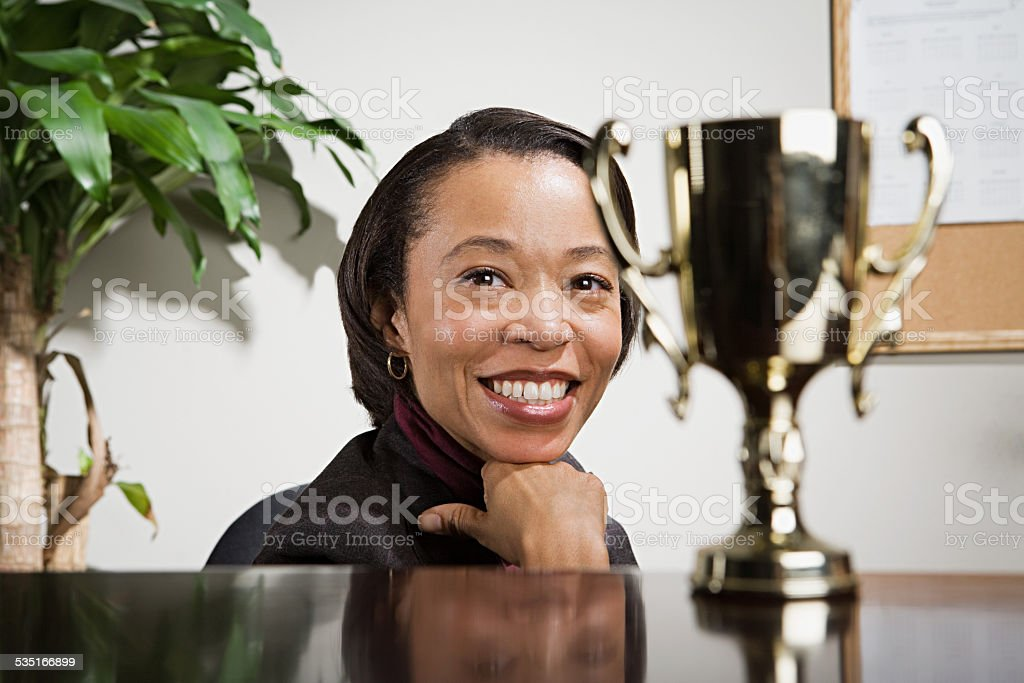 Business woman admiring her trophy stock photo