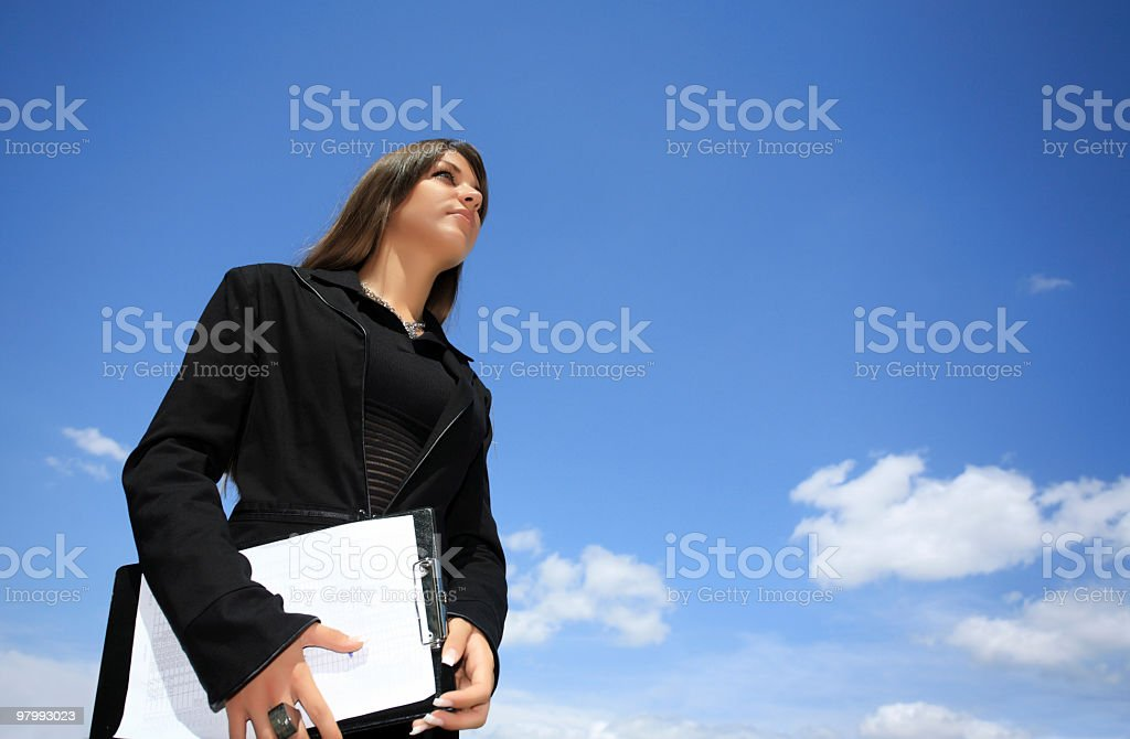 Business woman against the blue sky. royalty-free stock photo