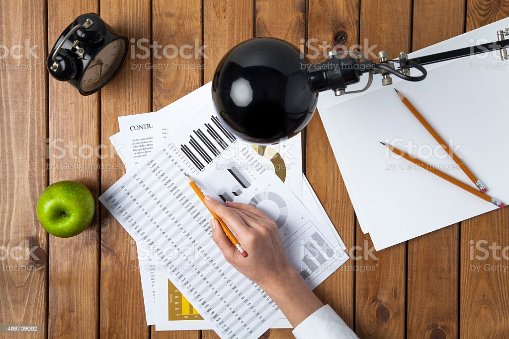 Business woman analyzing statistics stock photo