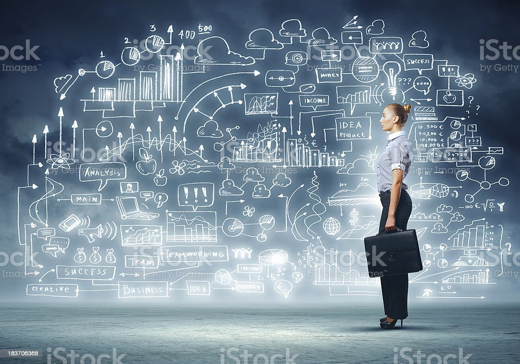 Business woman and  project businesswoman standing against business sketch Adult Stock Photo