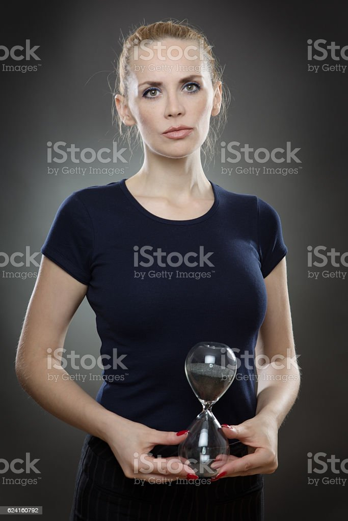 business woman and sand timer stock photo
