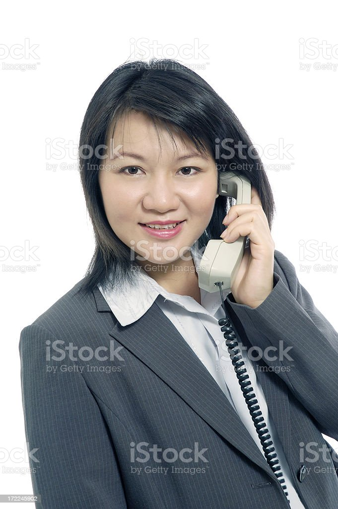 Business woman answering a call royalty-free stock photo