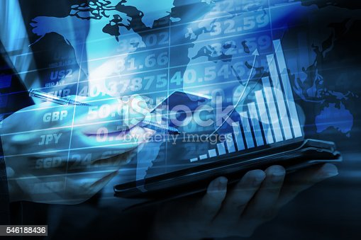 istock Business woman are checking exchange rates by using mobile phone 546188436