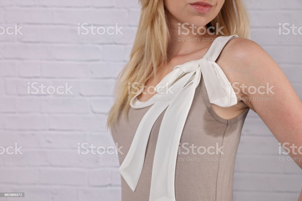 Business woman armpit sweating. Transpiration stain. Hyperthyroidism concept stock photo