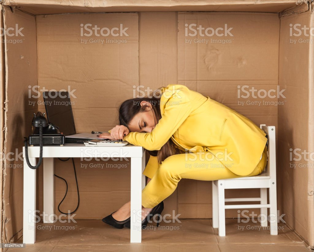 business woman asleep at his desk at work stock photo
