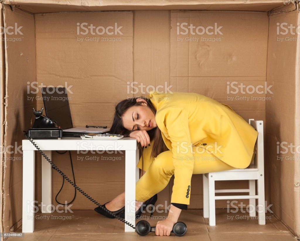business woman asleep during a telephone conversation stock photo