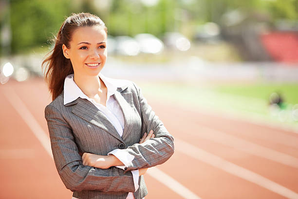 Business woman at athletic stadium stock photo