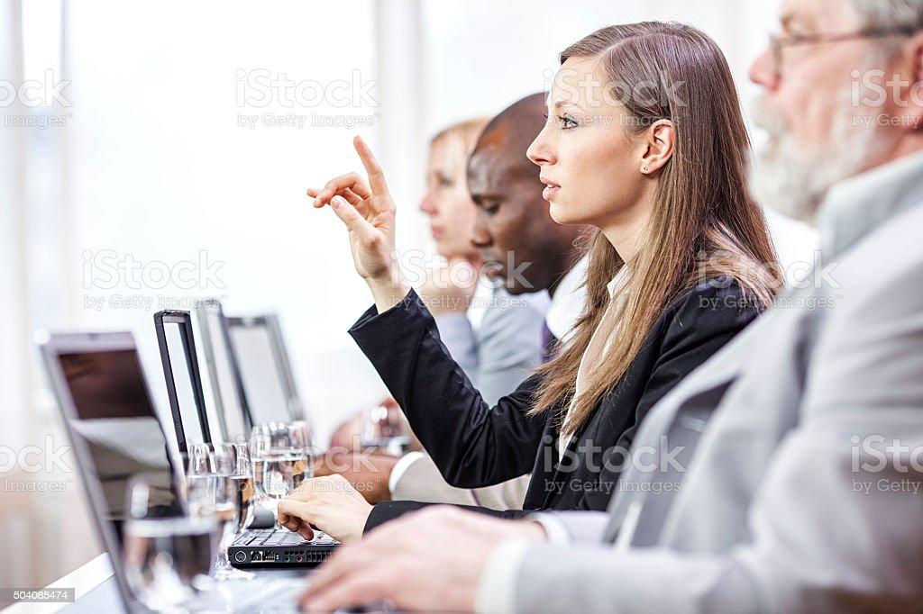 Business woman  at presentation raising hands stock photo