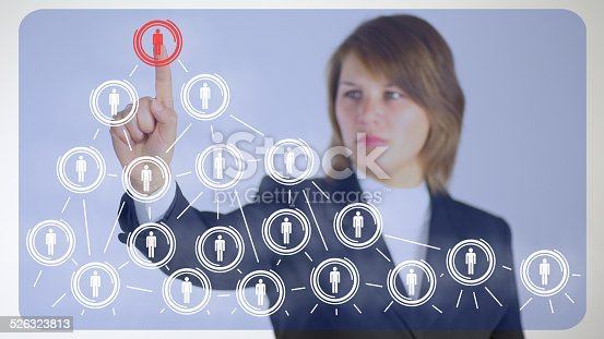 business woman before the virtual screen to the analysis of social networks
