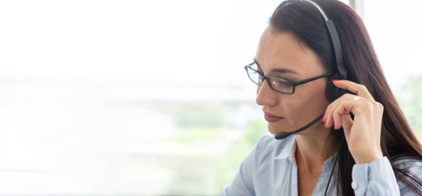 business woman call center and headset with copy space panorama banner . customer online service . operator. stock photo